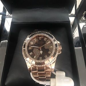 Limited edition Woman's Bebe gold watch